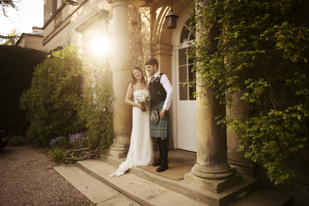 Bride and groom pictured outside Middleton Lodge wedding venue