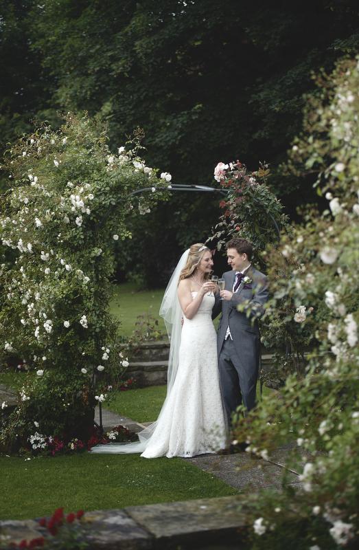Bride and groom pose for wedding photos, Wood Hall Hotel Wedding
