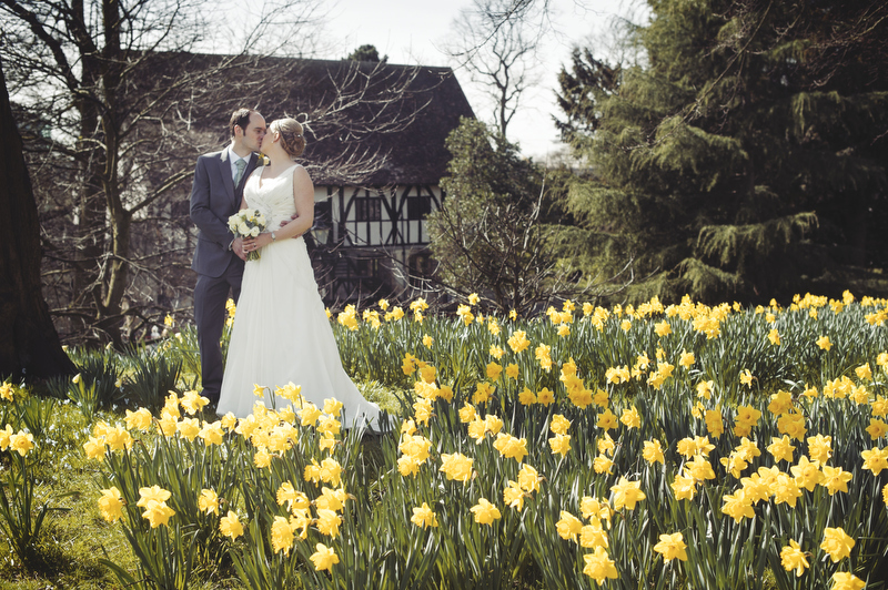 Bride and Groom pose in daffodils, the Hot