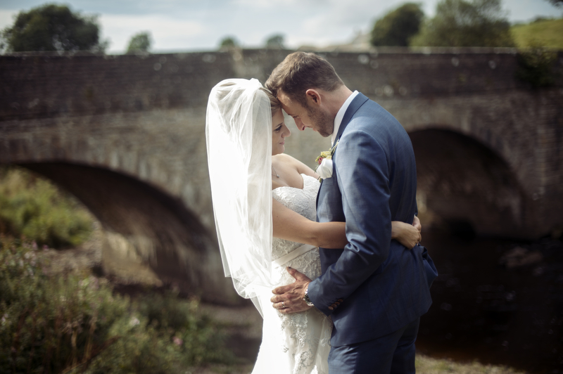 Bride and Groom pose for Wedding Photography at Yorebridge House