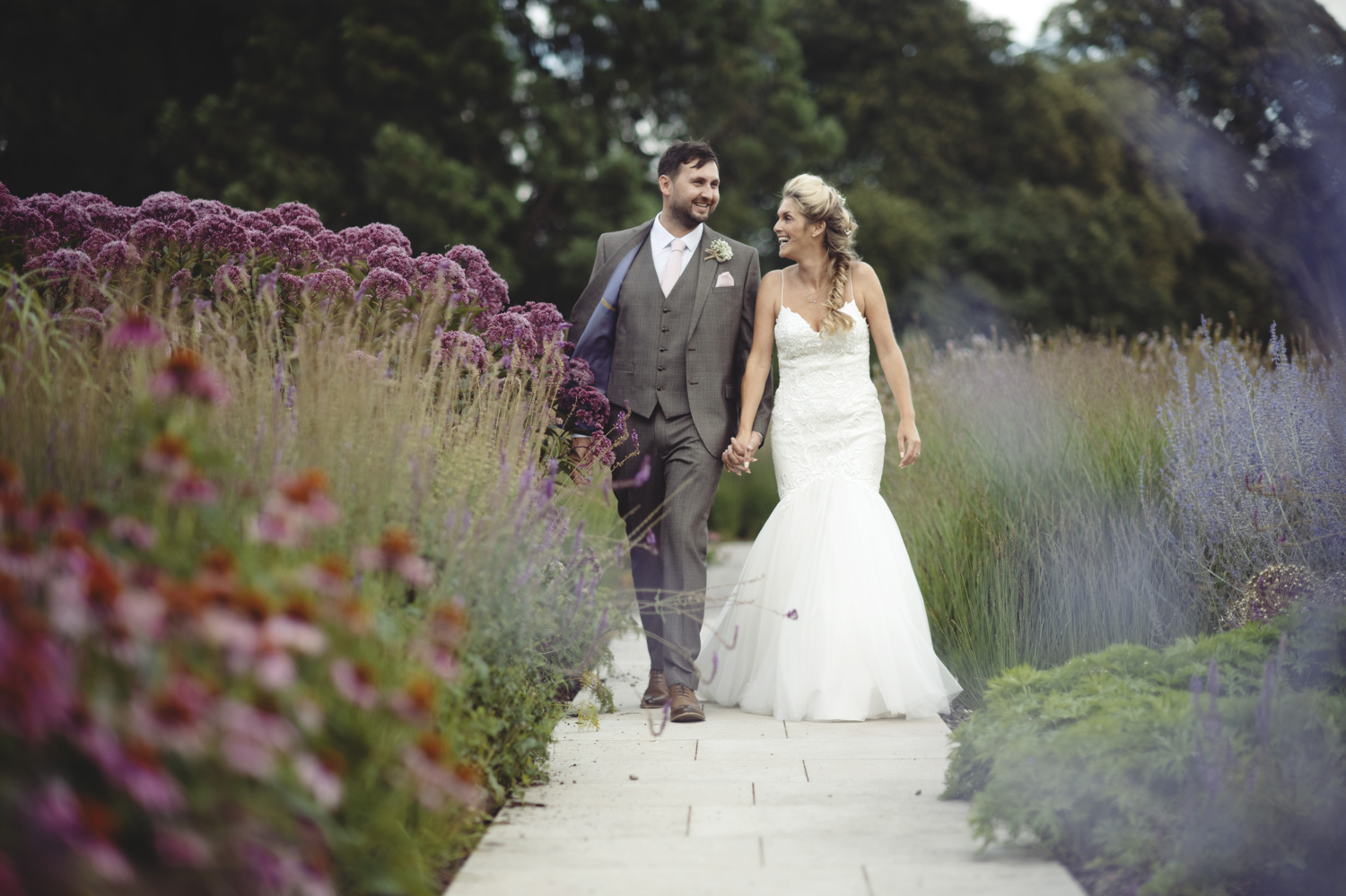 Bride and groom kiss in the gardens at The Fig House, Middleton Lodge Wedding