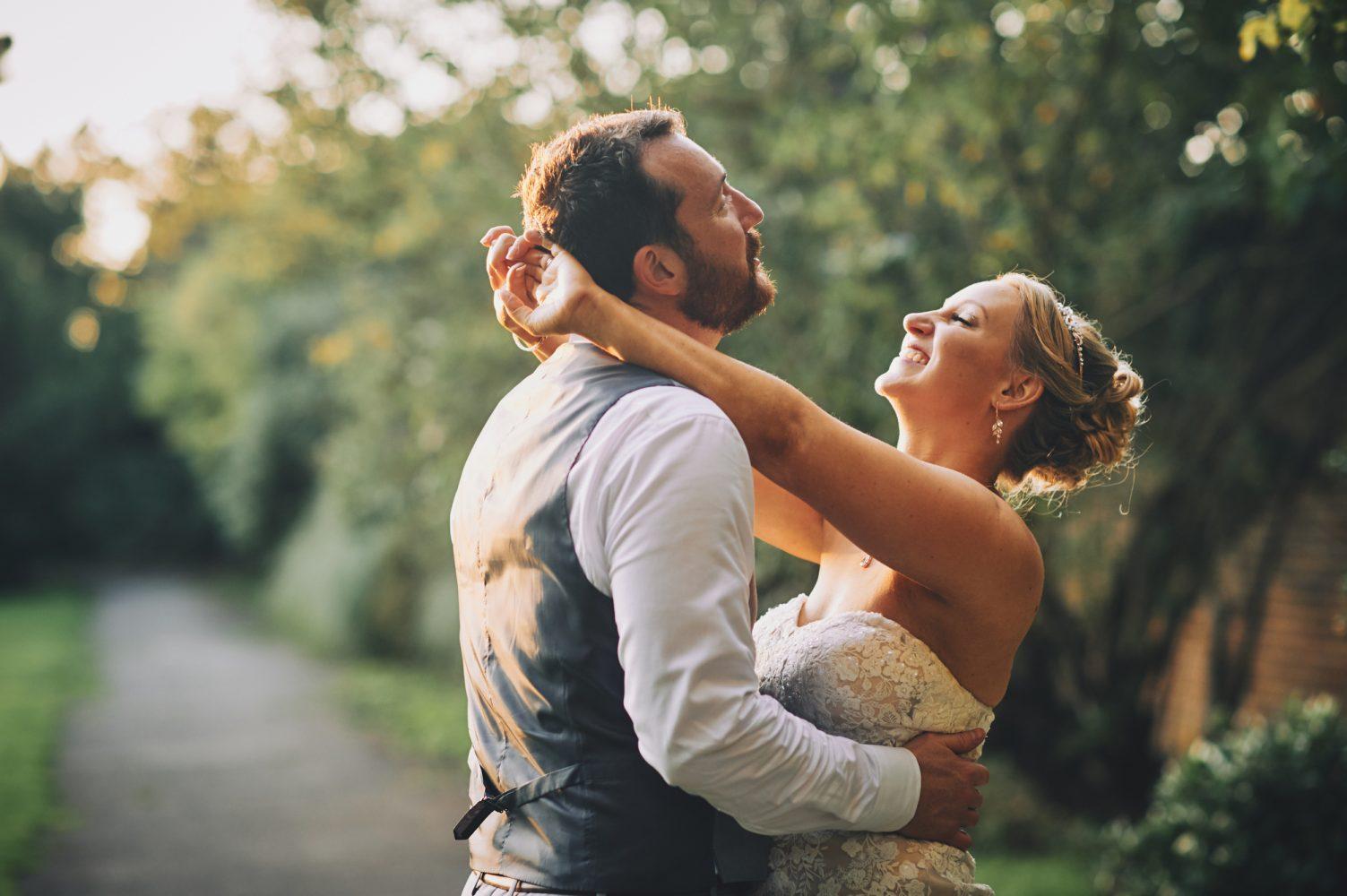 Bride and Groom sunset portraits Hampton Court House wedding Photographer